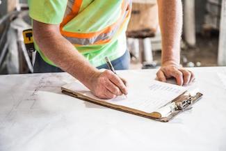 man-paper-clipboard-checklist-construction