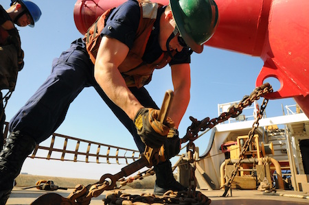 man-construction-hydraulic-jacks-repair-foundation